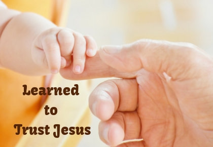 Childs hand in Father hand with trust